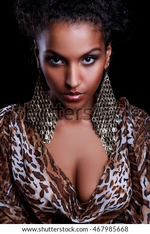 Portrait of a beautiful young black girl in a leopard dress