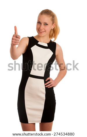 Portrait of a beautiful young blond caucasian business woman in black and white garment showing thumb up as a sign of success isolated over white background - stock photo