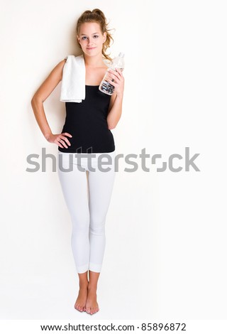 Portrait of a beautiful young blond fitness woman. - stock photo