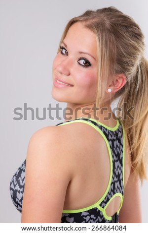 Portrait of a beautiful young blond woman ready for workout. - stock photo