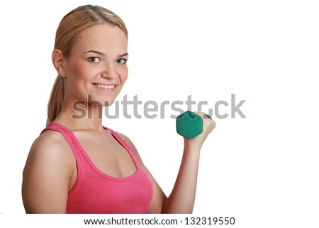 Portrait of a beautiful young blonde girl smiling and holding a green dumbbell isolated against a white background.