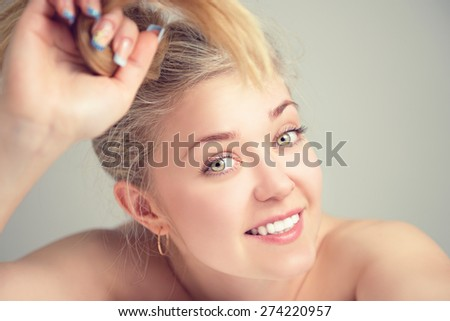 Portrait of a beautiful young blonde woman.