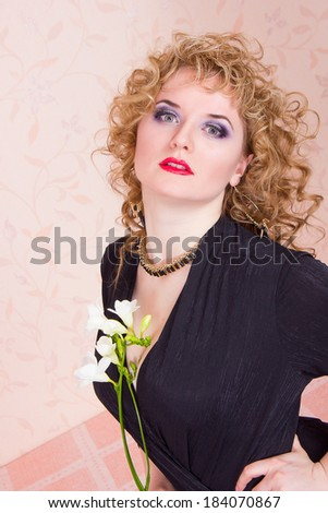 Portrait of a beautiful young blonde woman in a retro style. Girl dressed in a black bodysuit, shows emotion
