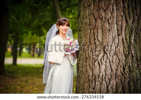 Portrait of a beautiful young bride - stock photo