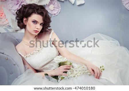 Portrait of a beautiful young bride in an elegant dress