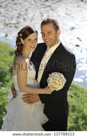 Portrait of a beautiful young bride smiling on her wedding day with her handsome groom