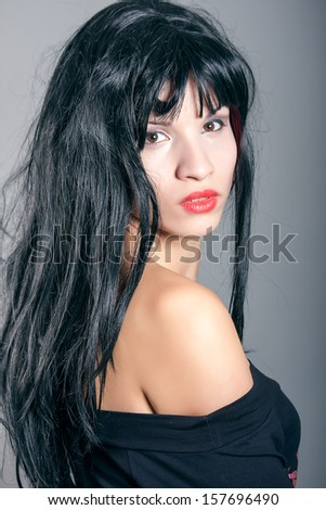 portrait of a beautiful young brunette - stock photo