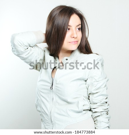 portrait of a beautiful young brunette girl dressed trendy.