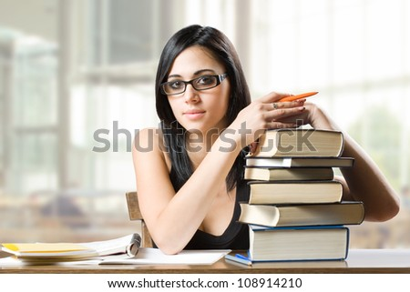 Portrait of a beautiful young brunette student woman. - stock photo