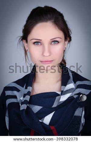 Portrait of a beautiful young brunette woman  - stock photo