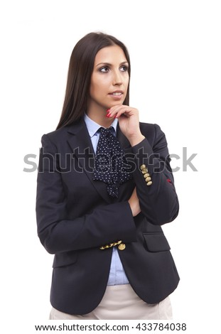 Portrait of a beautiful young business woman thinking against - stock photo