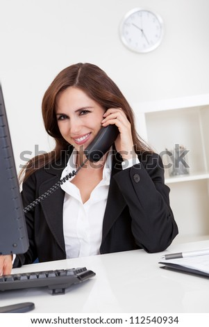 Portrait of a beautiful young businesswoman calling on the phone - stock photo