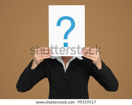 portrait of a beautiful, young, businesswoman, holding a sheet of paper with a question mark sign in front of her head, on beige background