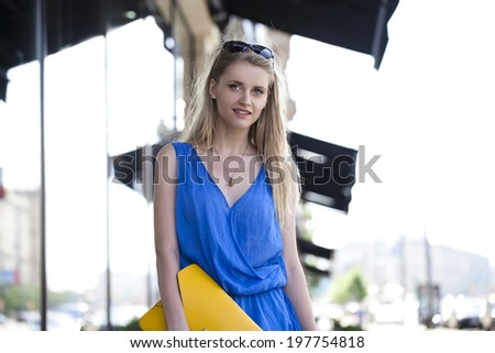 Portrait of a beautiful young Caucasian woman outdoor  - stock photo