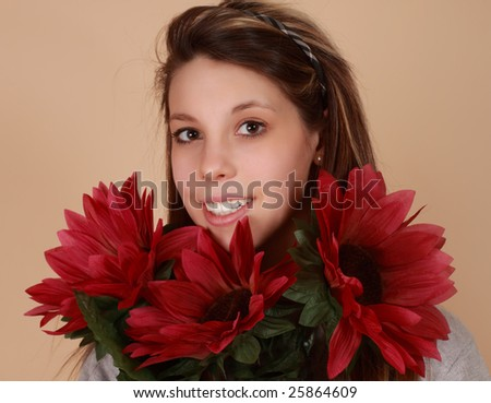 portrait of a beautiful young caucasian woman with fake flowers