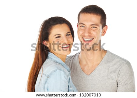 Portrait of a beautiful young couple / Cheerful young couple standing on white background