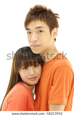 Portrait of a beautiful young couple. Shot in a studio.
