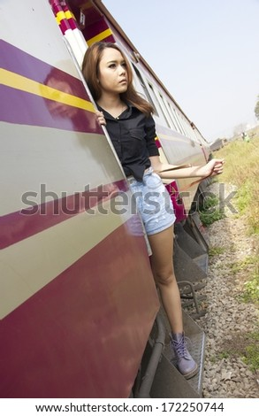 Portrait of a beautiful young cute asian female on train