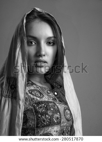 Portrait of a beautiful young eastern woman with shawl