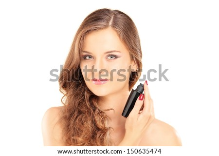 Portrait of a beautiful young female applying a perfume isolated on white background - stock photo