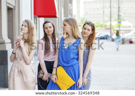 Portrait of a beautiful young four fashion women walk on summer city - stock photo