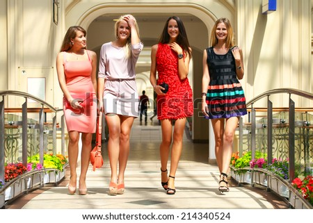 Portrait of a beautiful young four women walking in shop - stock photo