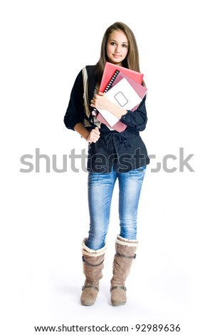 Portrait of a beautiful young friendly brunette student girl.