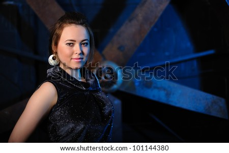 Portrait of a beautiful young girl against grunge background - stock photo