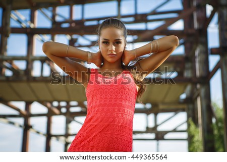 Portrait of a beautiful young girl at a construction site premises