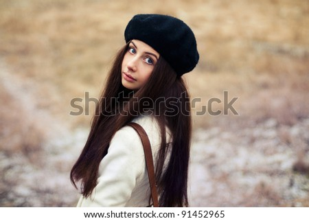 portrait of a beautiful young girl in autumn park