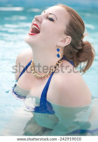 Portrait of a beautiful young girl in the pool