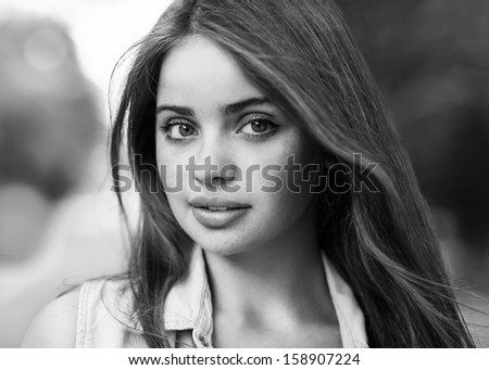 Portrait of a beautiful young girl looking at the camera. - stock photo