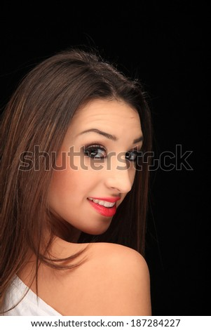 portrait of a beautiful young girl on a black background