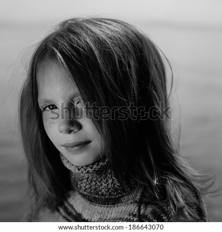 portrait of a beautiful young girl on nature, art photo of a child - stock photo