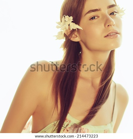 Portrait of a beautiful young girl on the beach in a summer dress, close up