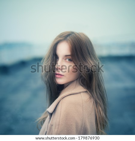 portrait of a beautiful young girl on the roof - stock photo