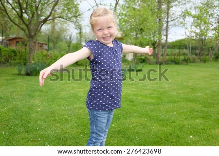 Portrait of a beautiful young girl outdoors in the garden - stock photo
