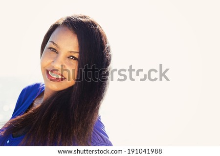 Portrait of a beautiful young girl smiling with copyspace - stock photo