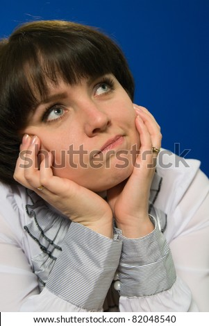 Portrait of a beautiful young girl thought - stock photo