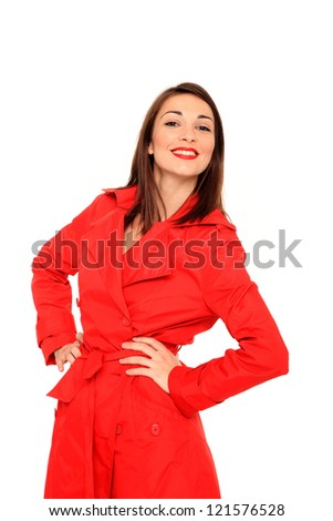 portrait of a beautiful young girl wearing a red coat isolated on a white background
