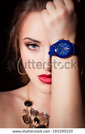 Portrait of a beautiful young girl, wearing watches on her hand - stock photo