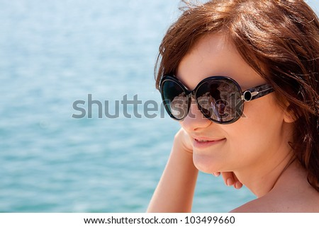 portrait of a beautiful young girl who rests on the coast