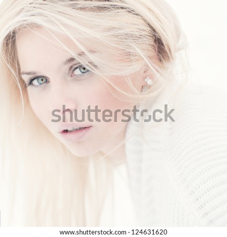 portrait of a beautiful young girl with an attractive look - stock photo