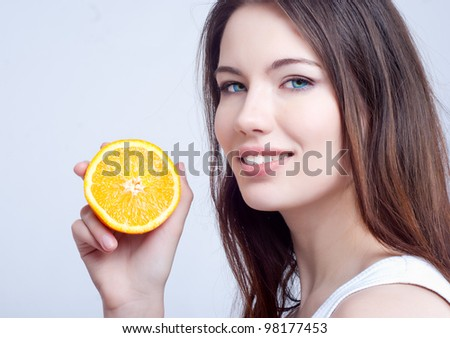 Portrait of a beautiful young girl with an orange