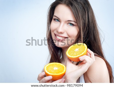 Portrait of a beautiful young girl with an orange - stock photo