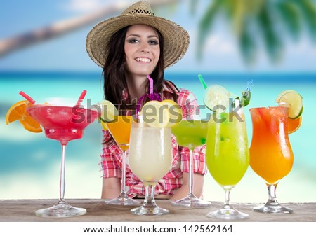 Portrait of a beautiful young girl with cocktail on the beach - stock photo