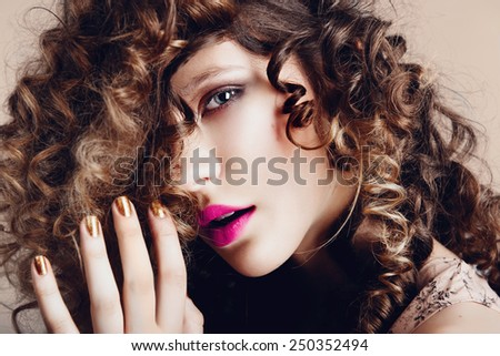 Portrait of a beautiful young girl with curly hair in the studio, the concept of health and beauty - stock photo