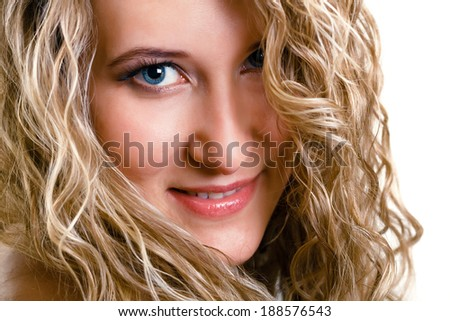 portrait of a beautiful young girl with long blond wavy hair. isolated on white