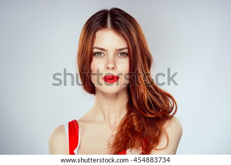 portrait of a beautiful young girl with red lips