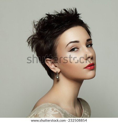 Portrait of a beautiful young girl with short hair. Beauty photo. Black and white. - stock photo